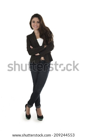 Fullbody shot of casual young beautiful brunette girl posing crossing arms isolated on white