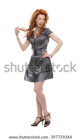 Fulllength shot of a redhead in a grey dress