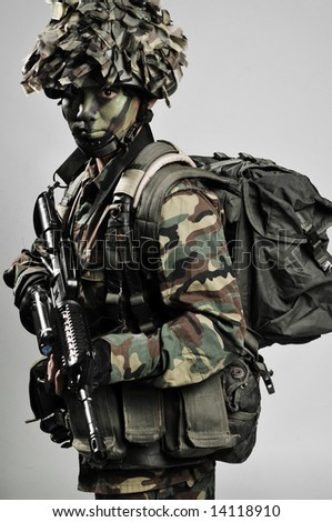fully armed and equipped soldier - stock photo