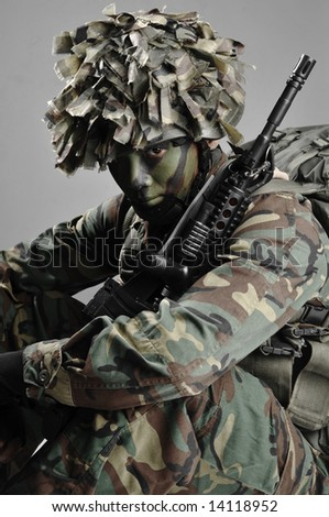 fully armed and equipped soldier staring over - stock photo