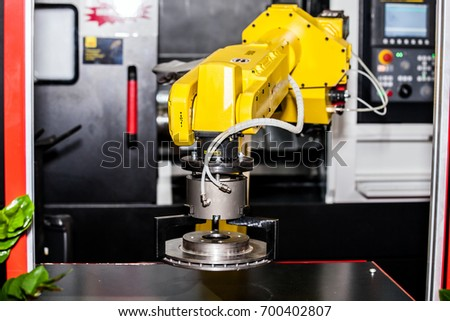 Fully automated CNC machining with handling robot