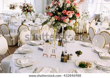 Fully decorated white wedding table - stock photo