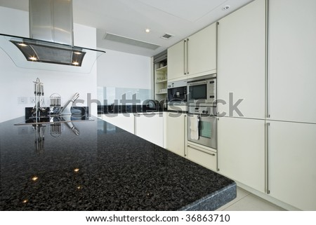 fully fitted modern kitchen with all appliances - stock photo
