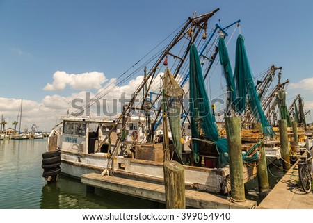 FULTON TX - MAR 27, 2016: Texas Gulf Coast shrimp boats in Fulton Harbor on Texas Coastal Bend after successful morning of shrimping.
