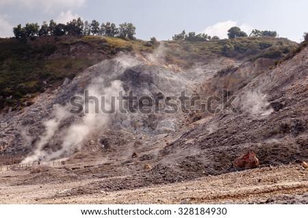 Fumarole and crater walls of active vulcano Solfatara di Pozzuoli near Napoli - Italy - stock photo