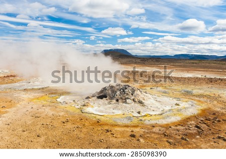 Fumarole in the geothermal area Hverir, Iceland. The area around is multicolored and cracked.  - stock photo