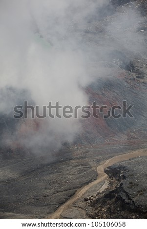 Fumarole smoke over the Poas Volcano in Costa Rica in 2012. Detail of the acid water crater with turquoise colors. - stock photo