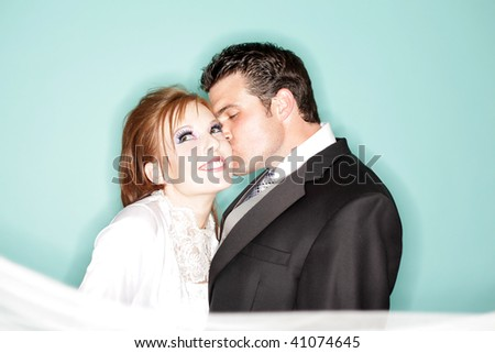Fun and modern wedding portrait - stock photo