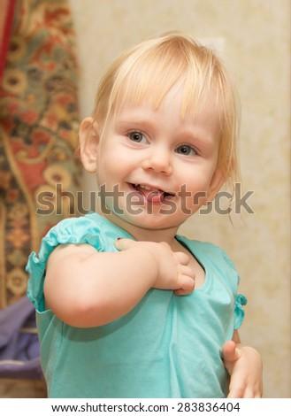Fun baby girl showing tongue - stock photo