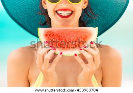 Fun beach summer holiday concept.  Woman holding watermelon on the beach.  - stock photo