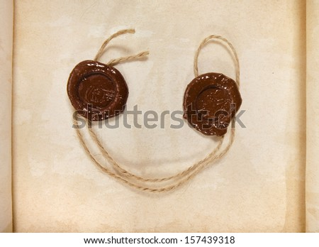 Fun Blank paper surface top view with two wax seal with rope close up macro - stock photo