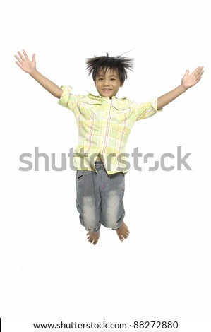 Fun boy in jeans high jump. Isolated.