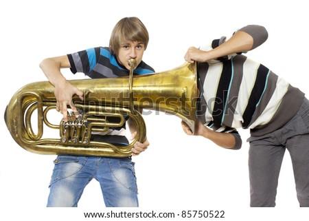 Fun boys enjoy with a trumpet - stock photo