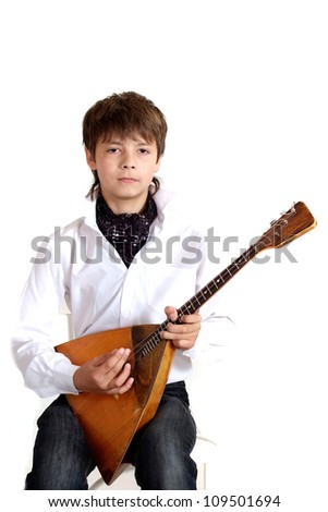 Fun child in the school of music on a white background - stock photo