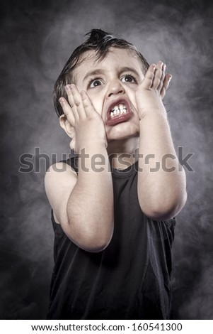 Fun, child rocker dress and funny expressions crested - stock photo