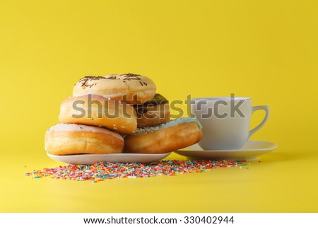 Fun donuts on bright yellow background