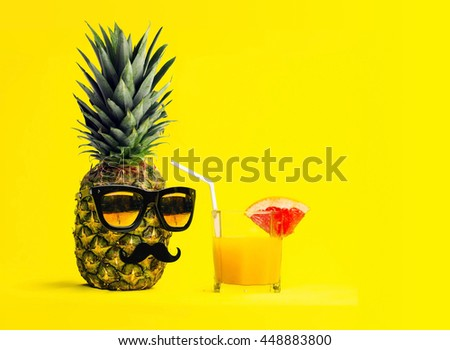 Fun Fashion pineapple with sunglasses and mustache with fresh tropical cocktail with fruit over yellow background. Vacation and travel concept. - stock photo