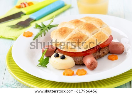 Fun food for kids - cute turtle shaped burger or creative hamburger for children made of ground meat pattie