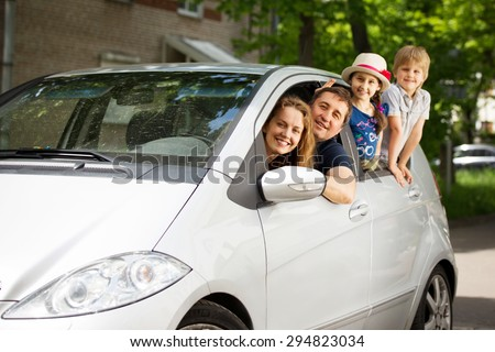 Fun friendly family is on a picnic. - stock photo