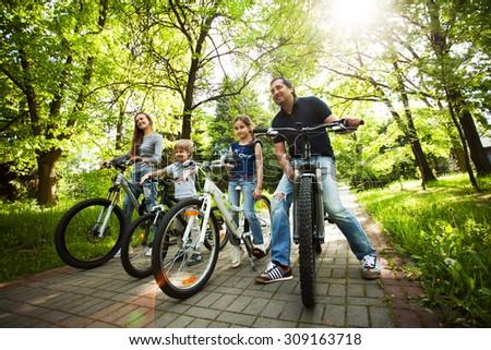 Fun friendly family is on a picnic. Biking. - stock photo