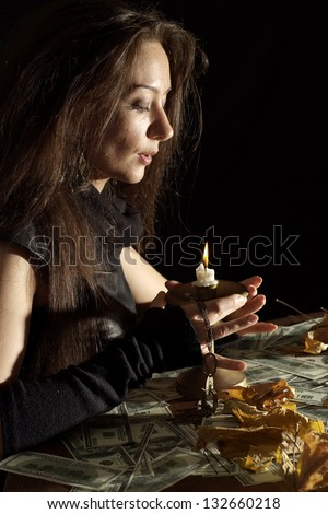 Fun girl as a witch on a dark background - stock photo