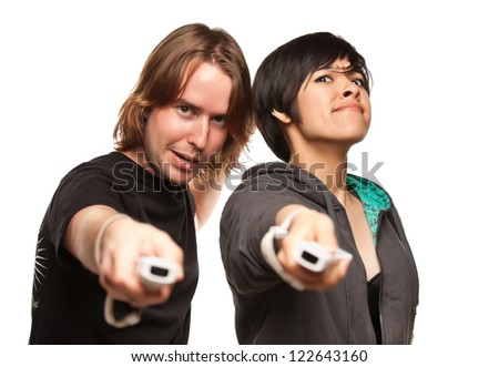 Fun Happy Mixed Race Couple Playing Video Game Remotes Isolated on a White Background. - stock photo