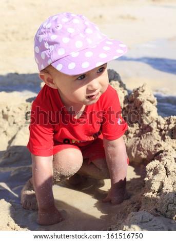 Fun in beach sand - stock photo