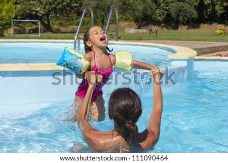 Fun in the swimming pool - stock photo