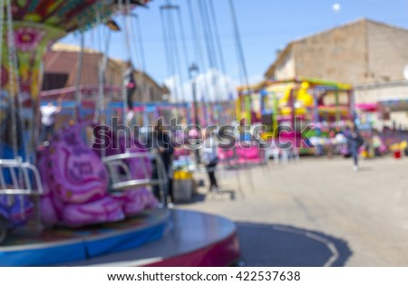 Fun in theme park abstract motion blur - stock photo