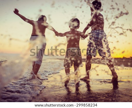 Fun kids playing splash at beach