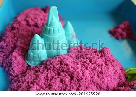 Fun kinetic sand. - stock photo
