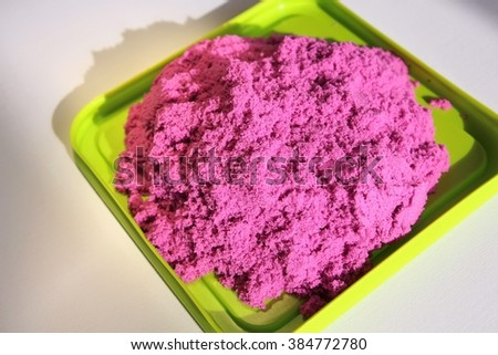 Fun kinetic sand. Purple kinetic sand for indoor children creativity games