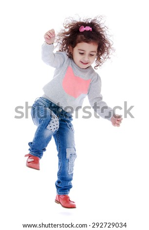 Fun little curly girl fun jumps - isolated on white background - stock photo