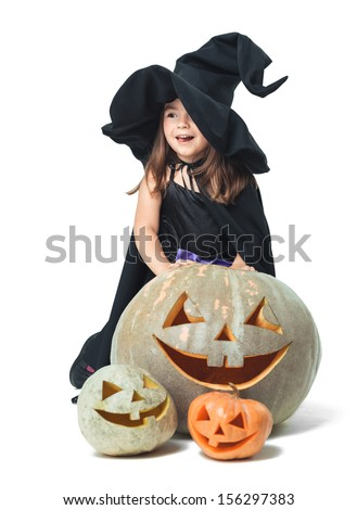 fun little witch hiding behind pumpkins