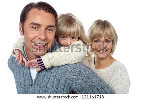 Fun loving family of three. Father, mother and daughter.