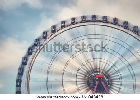 Fun on the ferries wheel - Imagine to ride on a ferries wheel that is turning faster and faster ... - stock photo