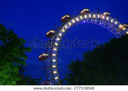 Fun park,colorful lights at night.Back to childhood. - stock photo