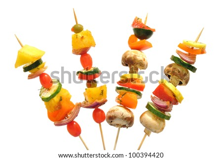 Fun way to eat healthy vegetables; kebabs with tomatoes, mushrooms, onions, zucchini, peppers - stock photo