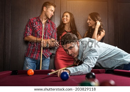 Fun with friends during playing billiard - stock photo