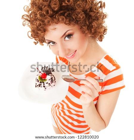 fun woman eating the cake on the white background - stock photo