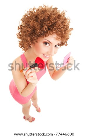 Fun woman with brush for makeup on the white background - stock photo