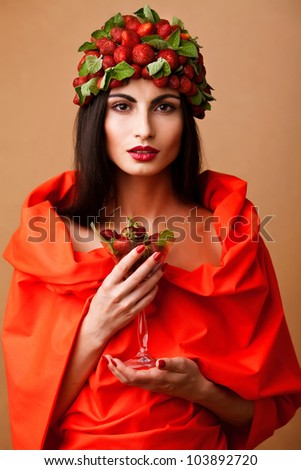 Fun woman with strawberry hat  and glass of strawberry coctail - stock photo