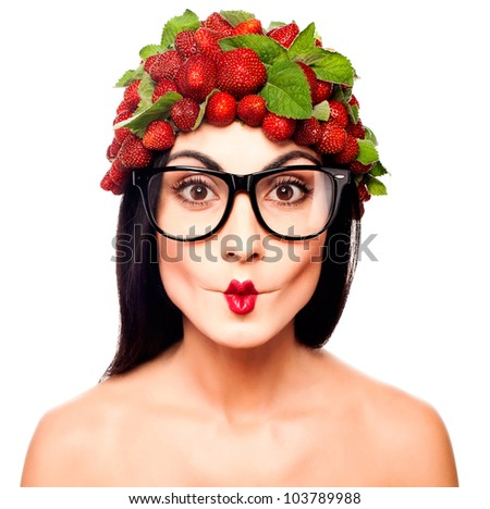 Fun woman with strawberry hat on the white background - stock photo