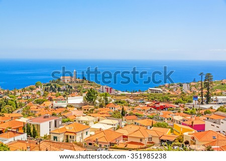 Funchal, Madeira - June 7, 2013: South coast of Funchal -view over the capital city, district Sao Martinho with civila parish church. View from Pico dos Barcelo - Atlantic Ocean in the background.
