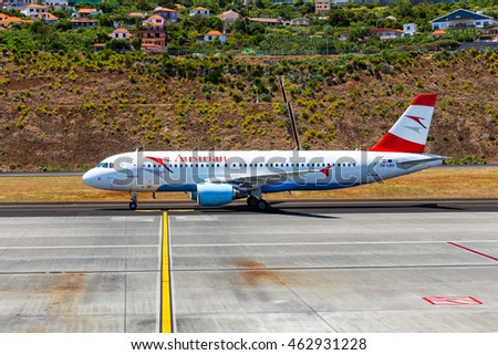 Funchal, Madeira, Portugal - July 7, 2016: At the airport of Madeira (Aeroporto Madeira) an Austrian Airlines airplane on runway.