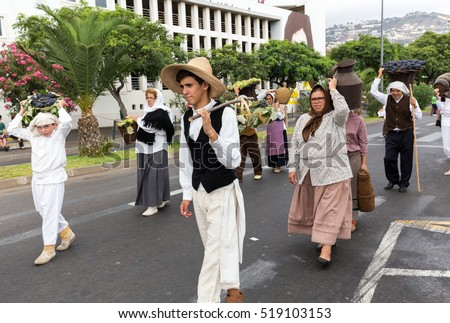 FUNCHAL, MADEIRA, PORTUGAL - SEPTEMBER 4, 2016: Group of people in traditional costume durnig historical and ethnographic  parade of Madeira Wine Festival in Funchal.