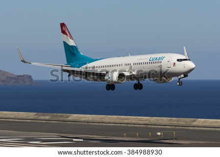 FUNCHAL, MADEIRA, PORTUGAL - SEPTEMBER 1: Luxair - Luxembourg Airlines Boeing 737 (LX-LGU) landing at Funchal Madeira Airport - FNC. September 1, 2014.