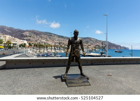 FUNCHAL, MADEIRA, PORTUGAL - SEPTEMBER 1, 2016: The staue Christiano Ronaldo before the entry to the Museum CR 7 in Funchal on Madeira. Portugal