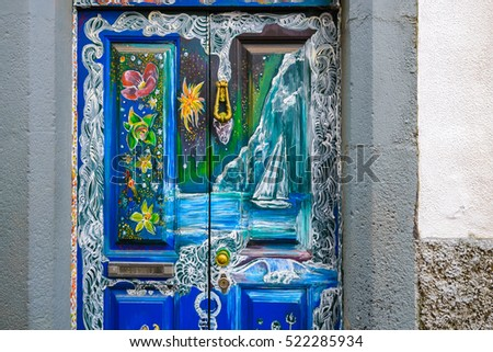 "FUNCHAL - NOV 15: Painted door of a house in the street of Santa Maria on November 15, 2014 in Funchal, Madeira island, Portugal. It is a part of ""The art of open doors"" project."