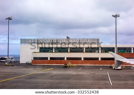 Funchal, Portugal - May 30, 2013: At the airport of Funchal, Island of Madeira after landing. Main gate. - stock photo